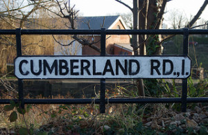'Cumberland Road' street sign with multiple punctuation marks